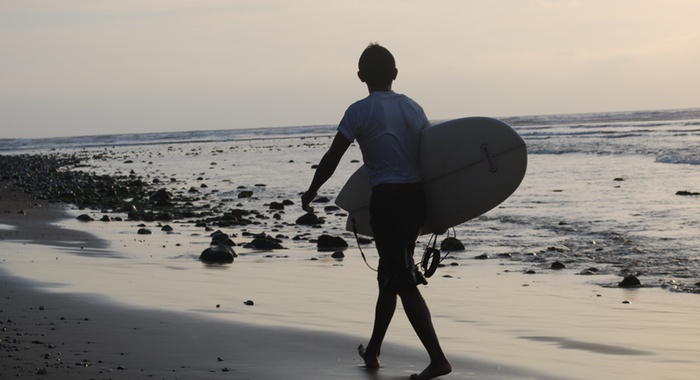 Shortboarder at dusk